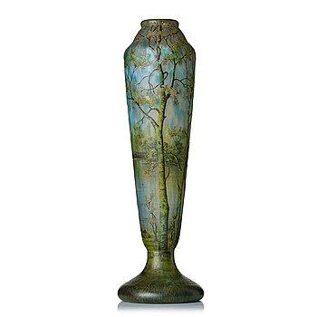 44. Daum, an Art Nouveau enamel painted cameo glass landscape vase.