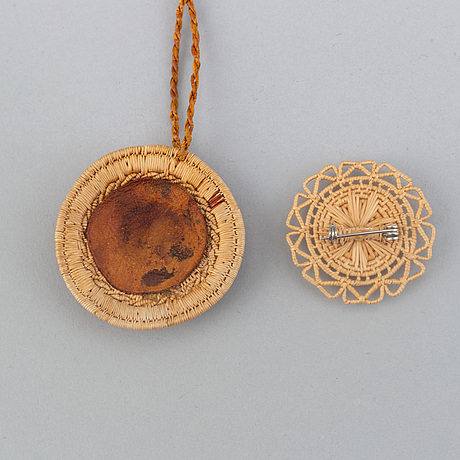 A sami root brooch and pendant.