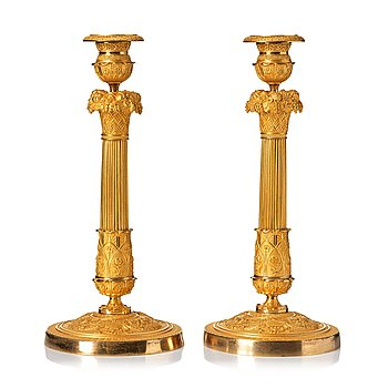 116. A pair of French Empire candlesticks, beginning of the 1800's.