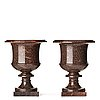 A pair if swedish porphyry urns, late gusavian early 19th century.