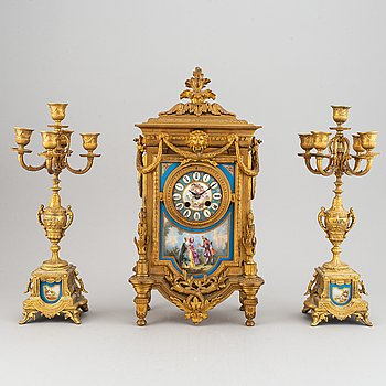 A late 19th century table clock and candelabra, probably France.