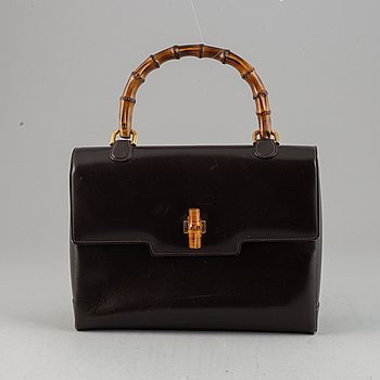 Gucci, a leather and bamboo bag.