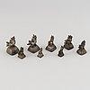Eight metal opium weights.