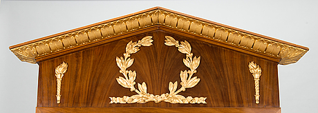 An empire-style mirror from the first quarter of the 19th century.