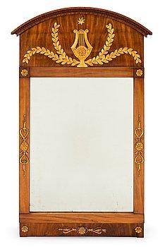 A Swedish Empire mirror by Jonas Frisk, Stockholm 1805-1824. With the label of Jon: Frisks Spegelfabrik.