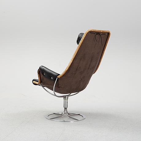 A 'jetson' swivel easy chair with leather upholstery by bruno mathsson, for dux.