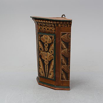A painted corner cabinet, dated 1794.