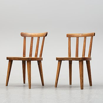 "An Axel Einar Hjort ""Utö"" pine chair & A Nordiska Kompaniet ""Ekerö"" pine chair, 1930's and 1940's."