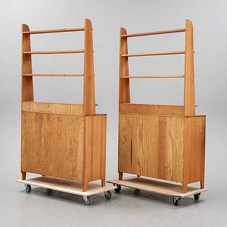 A pair of pine cupboards with shelves by carl malmsten.