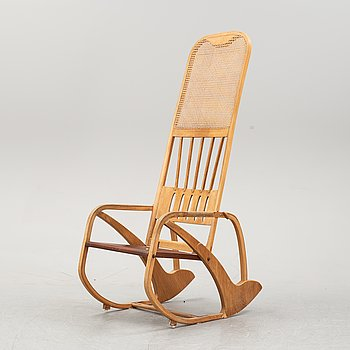 A beech and oak rocking chair, mid 20th Century.