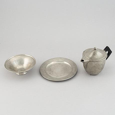 Firma svenskt tenn. a tea pot, a bowl and a platter. dated 1924, 1928 and 1960.