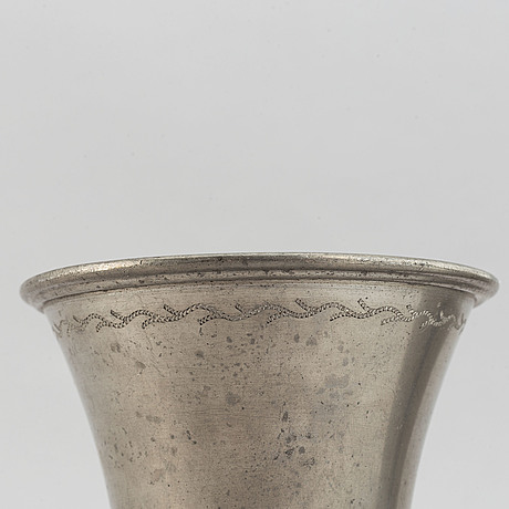 Two pewter vases and a pewter plate from svenskt tenn. dated 1928, 1948, and 1975.