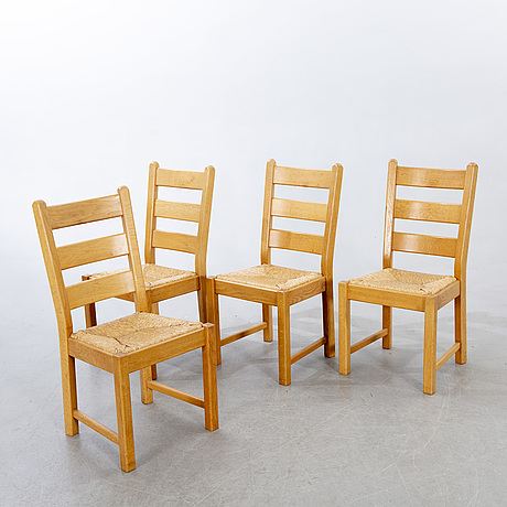 A set of four wicker and oak 1970s chairs.