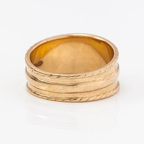 A 14k gold ring. kalevala koru, helsinki 2002.