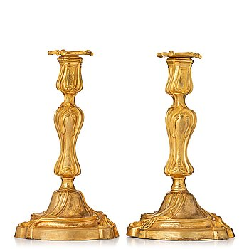 115. A pair of French 18th century gilt-bronz candlesticks, marked. Louis XV.