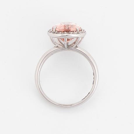 Drop shaped morganite and brililant-cut diamond ring.