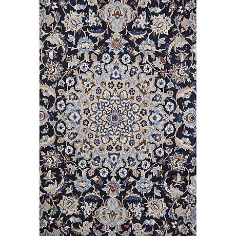 A rug, nain, part silk, 9 laa, 215 x 125 cm.