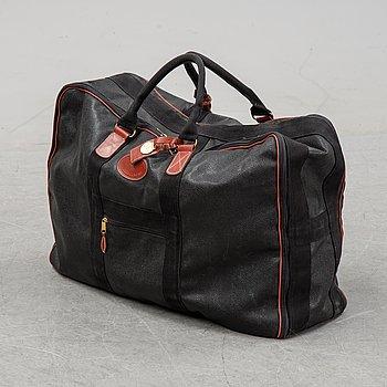 Mulberry, a black Scotch Grain suitcase.