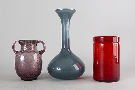 Erik höglund, a set of four glass vases and bowls. one flask by bertil vallien, kosta boda.