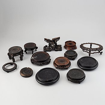 A group of Chinese wooden stands, 19th/20th Century. (13 pieces).