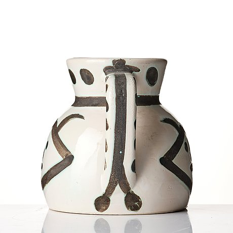 Pablo picasso, a faience pitcher, 'têtes', madoura, vallauris, france post 1956, a.r 368.