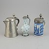 A group of three pewter and faience ewers, holland/germany, 18th/19th century.