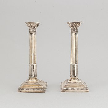 A pair of English silver candlesticks, marked Sheffield c. 1900.