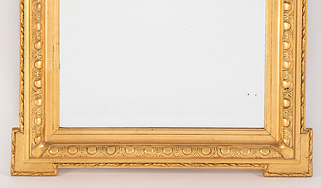 A mirror and console table from around the year 1900.