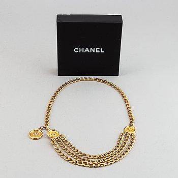 Chanel, a metal belt.