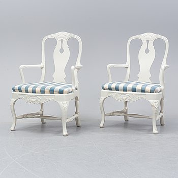 A pair of Rococo style armchairs, mid 20th Century.
