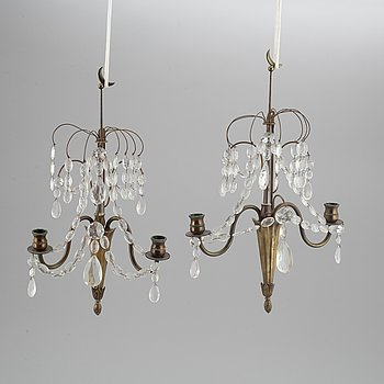 A pair of Swedish Gustavian style wall lights.