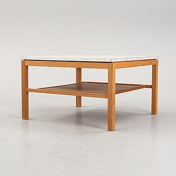 A 21st Century oak and limestone coffee table from G.A.D.