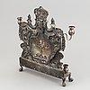 A 19th century silver chanukka-lamp.