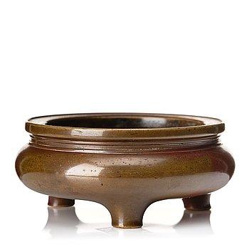 871. A copper alloy tripod censer, Qing dynasty (1664-1912).
