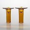 "Nanny still, a pair of 1960s 'ambra' glass candlesticks, signed ""ambra"", signed nanny still riihimäen lasi oy."