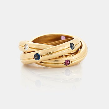 """365. A Cartier """"Trinity"""" ring in 18K gold set with round brilliant-cut diamonds, rubies and sapphires."""