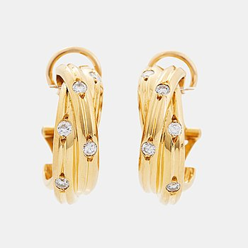 """366. A pair of Cartier """"Trinity"""" earrings in 18K gold set with round brilliant-cut diamonds."""