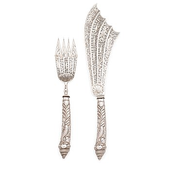 A pair of Victorian sterling silver fish servers, John Aldwinckle & Thomas Slater, London 1889. In original fitted case.