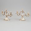 A pair of silver candelabras, swedish import mark.