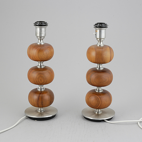 A pair of ab stilarmatur walnut and metal table lamps, sweden. second half of the 20th century.