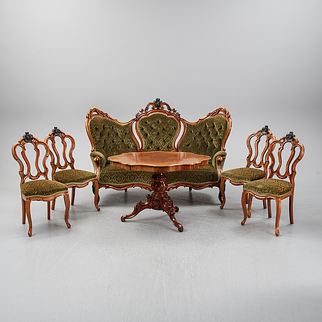 A rococo style sofa, four chairs and a table, second half of the 19th century.