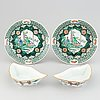 A pair of famille noire dinner plates and a pair of cabaret dishes, china, early 20th century.