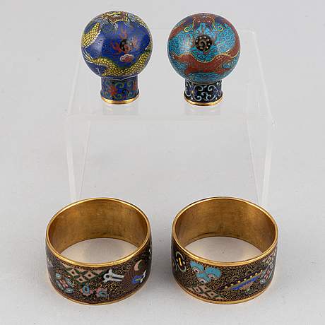 Two cloisonné cane tops and two napkin rings, china, first half of 20th century.