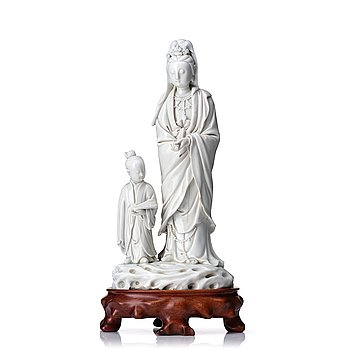 887. A blanc de chine figure of Guanyin and a servant, Qing dynasty, 19th Century.