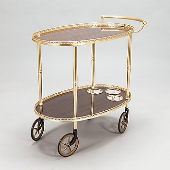 An Italian serving trolley in brass from 1960s-70s.