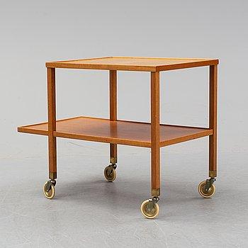A model 470 mahogany tea trolley by Josef Frank for Firma Svenskt Tenn, designed 1932.