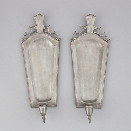 A pair of 20th century pewter wall sconces for ine candle.