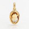 An 18k gold pendant with a citrine. tillander, helsinki.