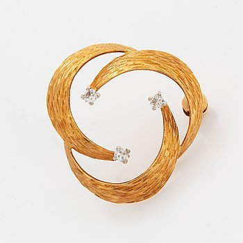 18K gold and faceted white stone broosch.