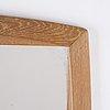 A mirrow with frame veneered with oak, swedish 1960s.